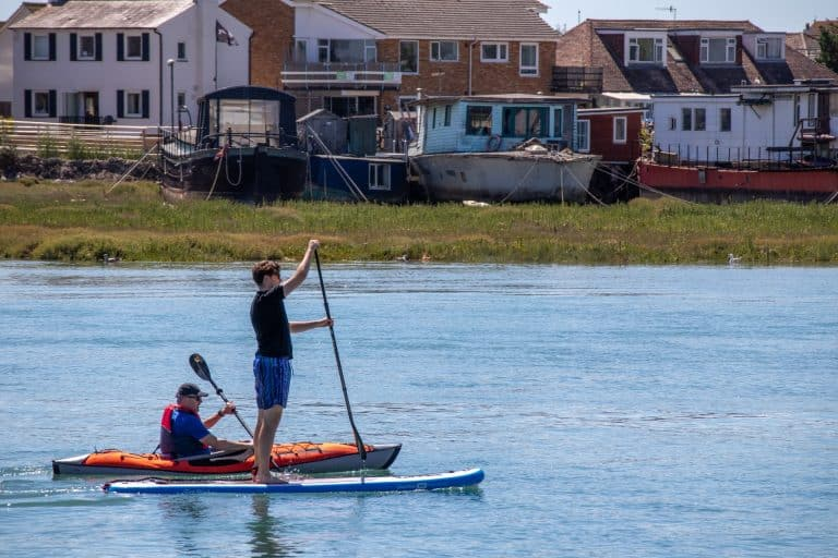 Paddle Board VS Kayak – Which Is Best For You?